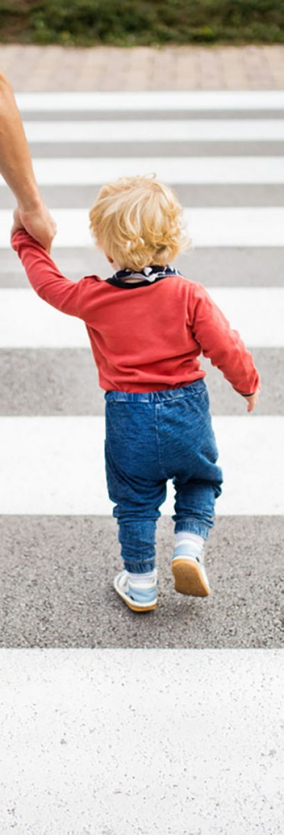 Father-with-little-boy-crossing-the-road-on-crosswalk